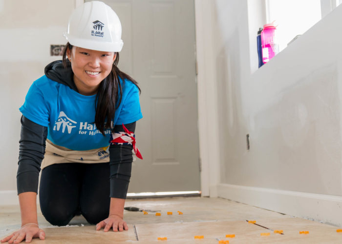 WINSTON-SALEM, NORTH CAROLINA, USA (03/07/17)- Michelle Milone, a sophomore from Villanova University, installs tile flooring during a Collegiate Challenge build in Winston-Salem, NC. ©Habitat for Humanity International/Jason Asteros